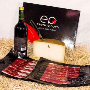 Dos sobres de paleta ibérica de cebo, una cuña de queso artesano y una botella de vino